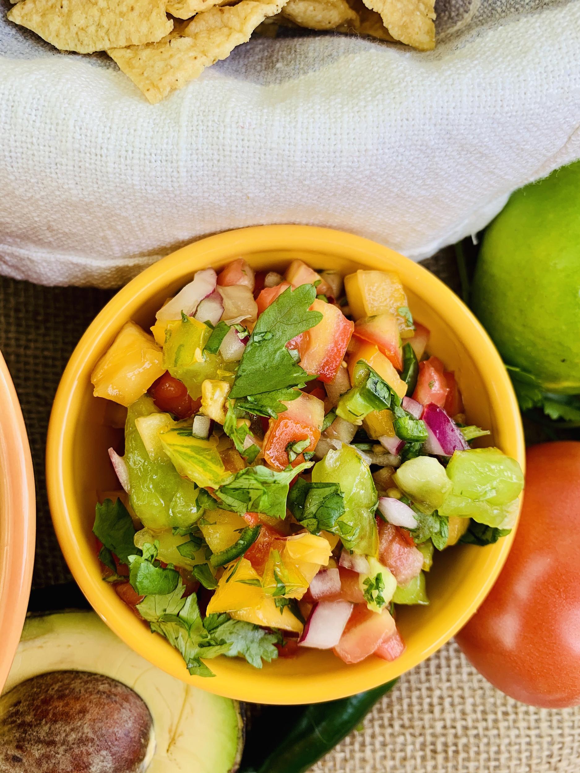 Bowl of fresh pico de gallo with tomatoes, onion, cilantro and lime
