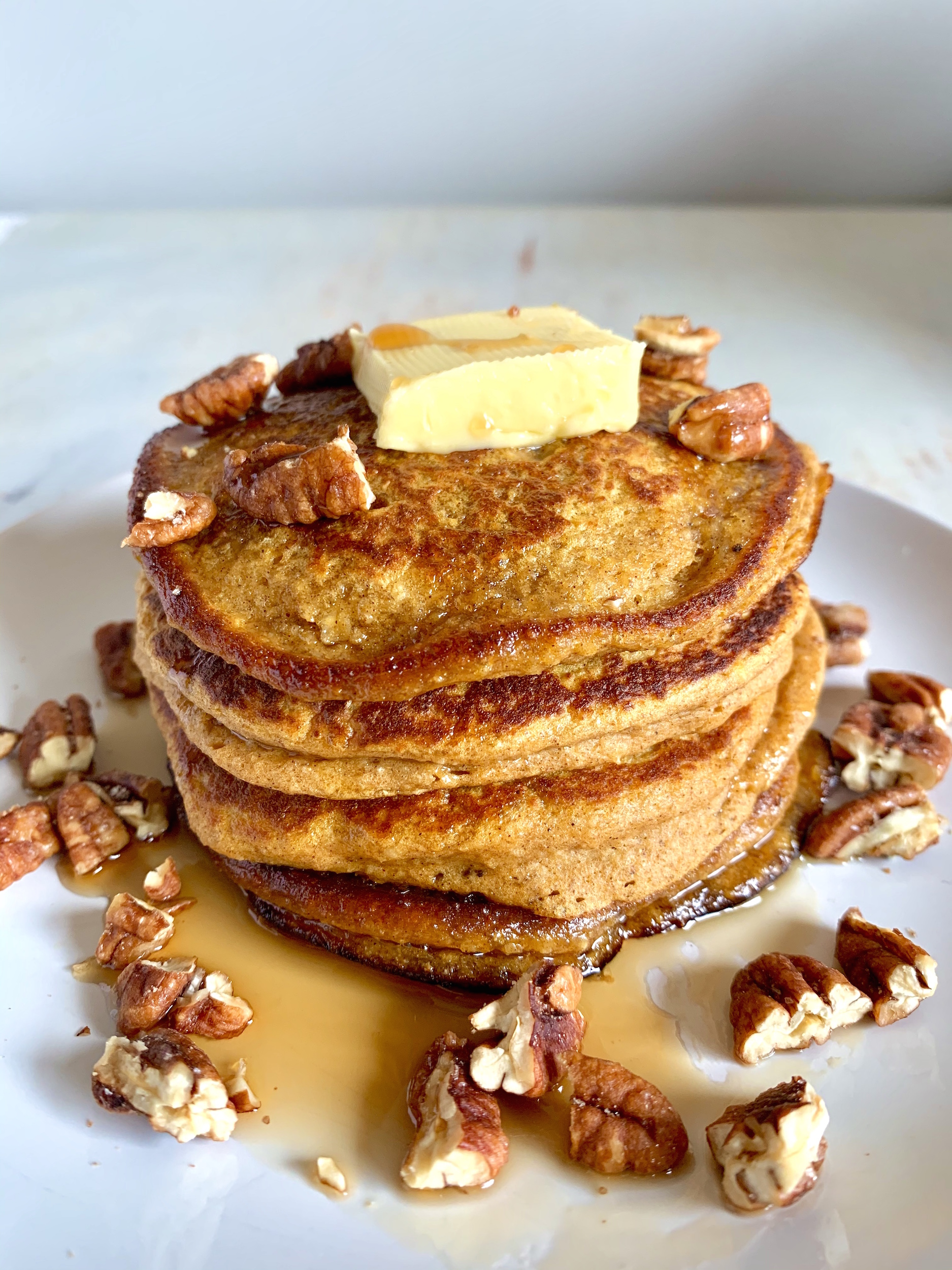 Stack of Sweet Potato Oatmeal Pancakes with butter and syrup
