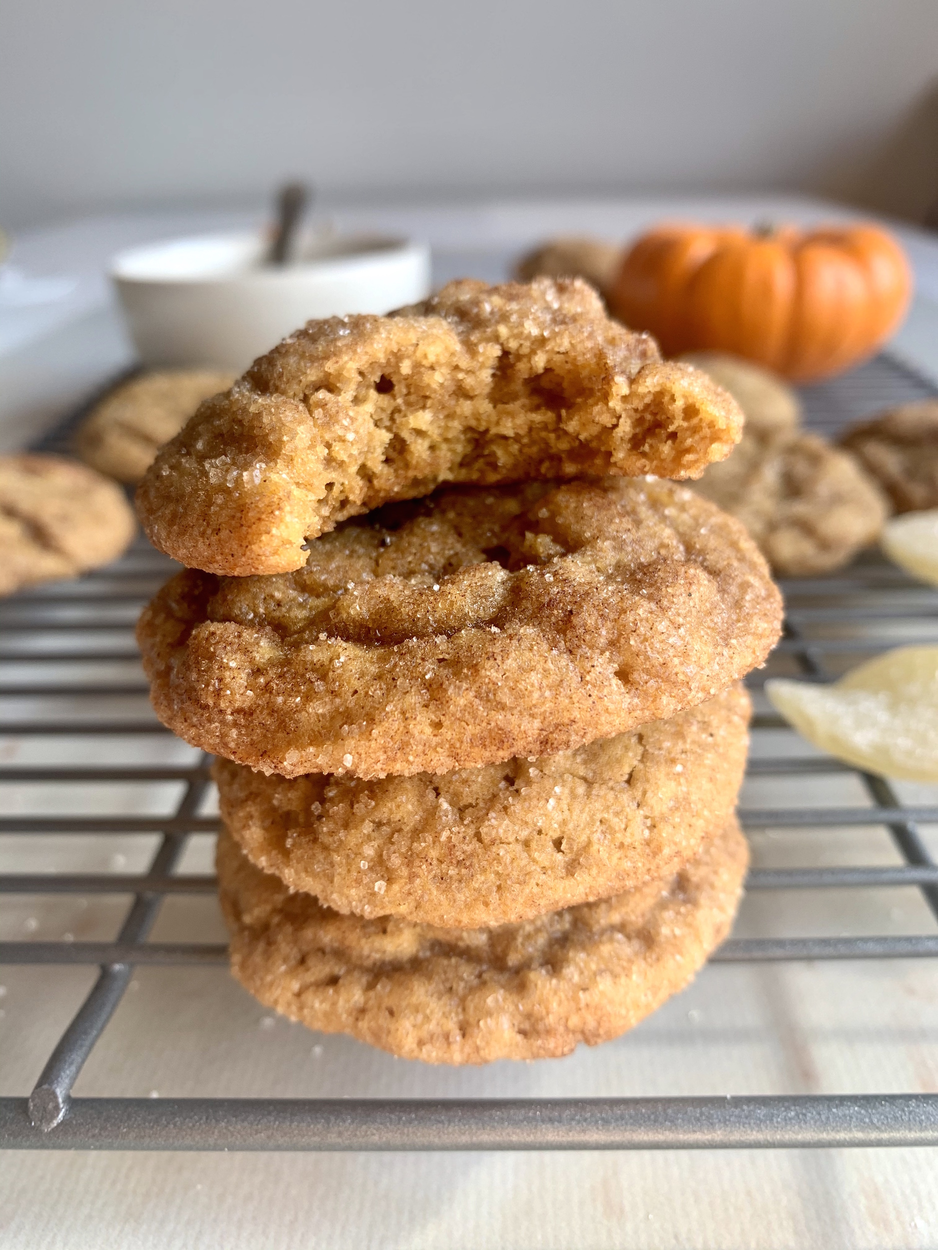 Stack of pumpkin snickerdoodle cookies with a bite out of the one on top!