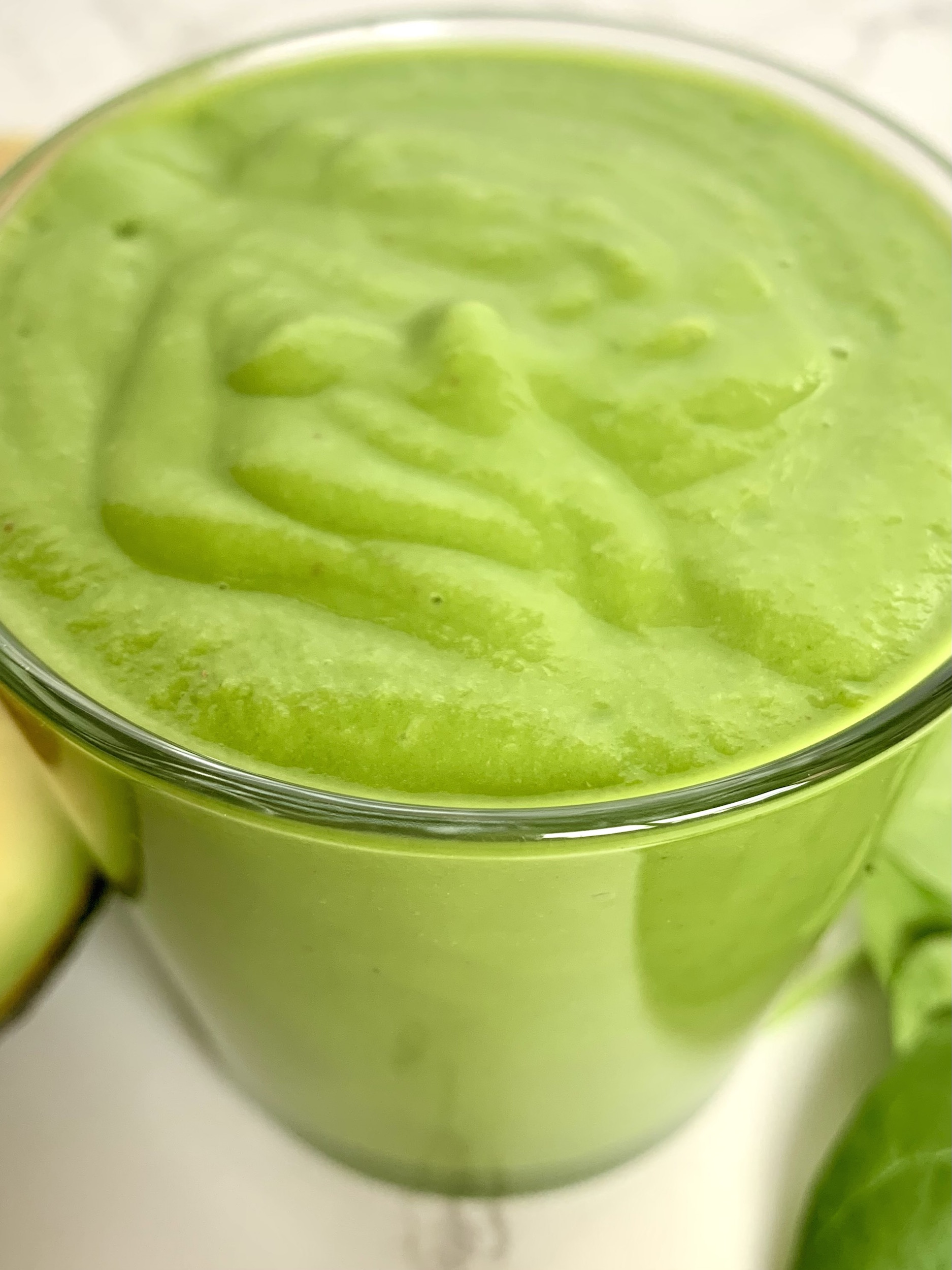 Close up of glass full of green machine smoothie