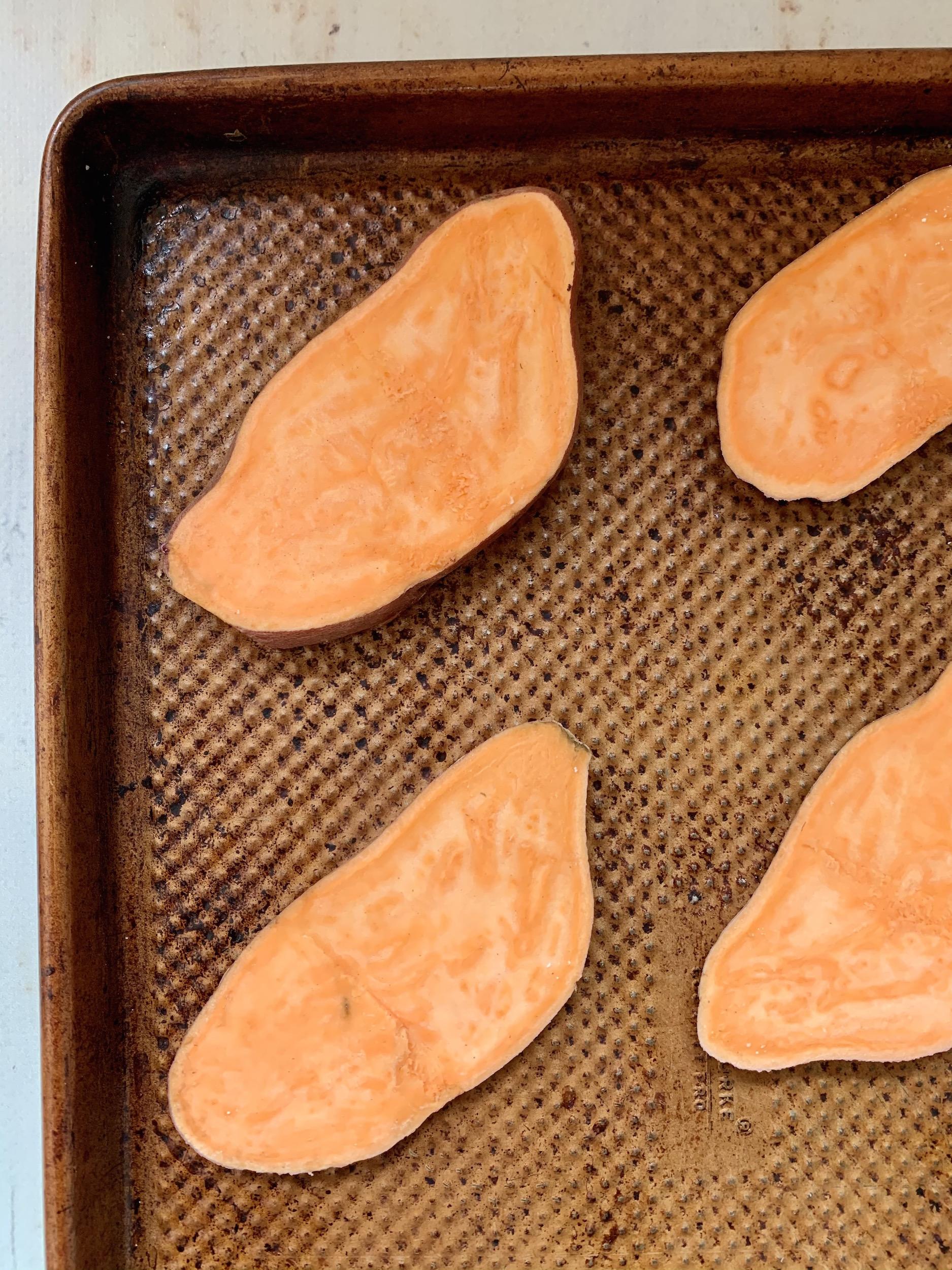 slices of raw sweet potato on a baking sheet