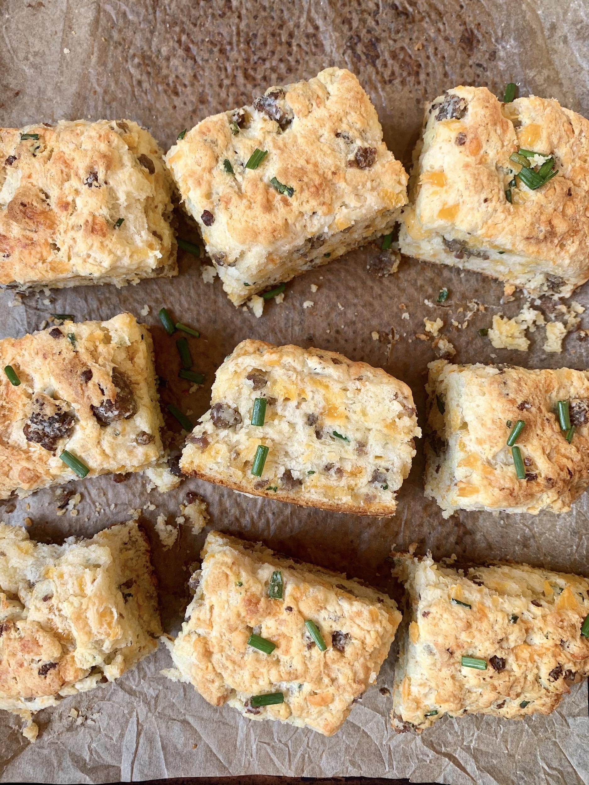 sausage cheddar biscuits on a baking sheeton a baking sheet