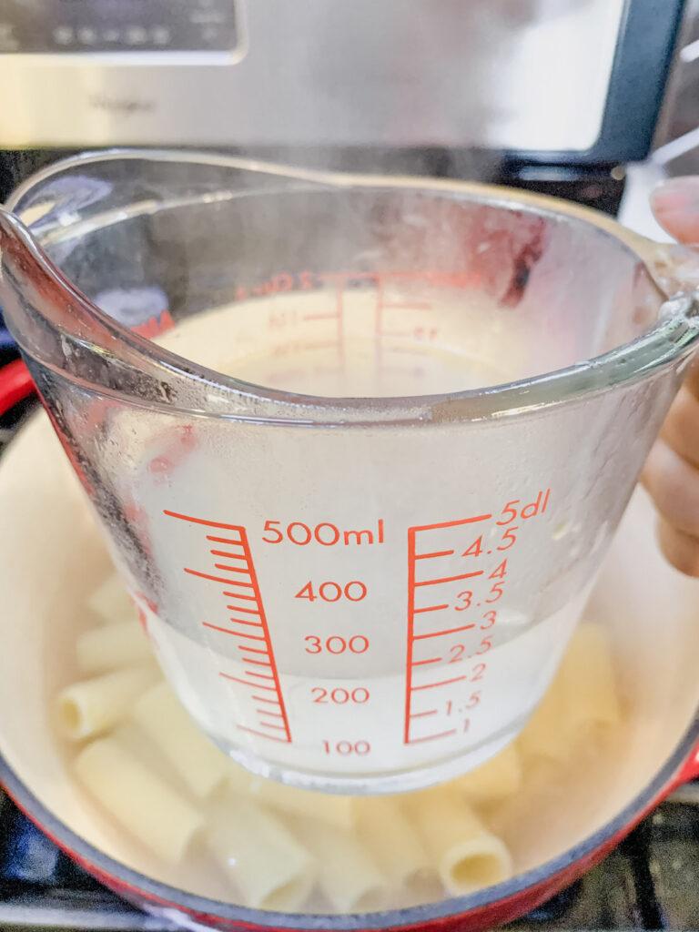 Pyrex measuring cup full of pasta water