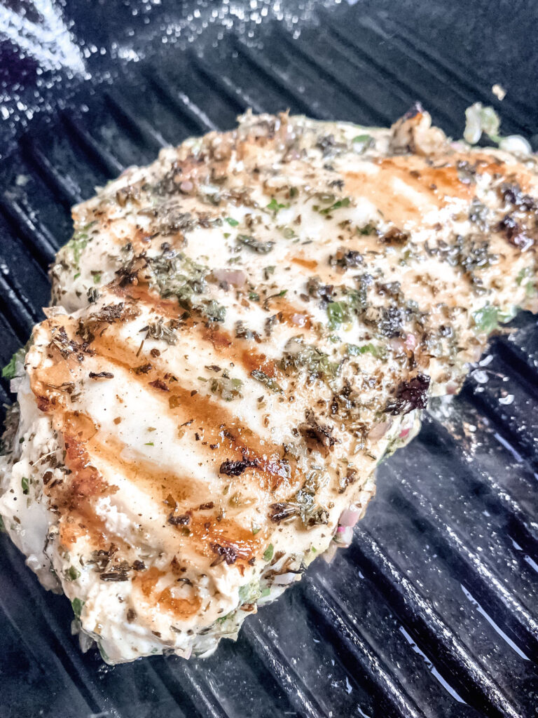 Grilled mediterranean chicken cooking on the grill