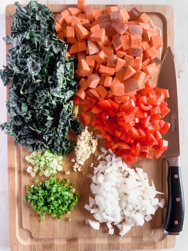 Diced veggies on a wood cutting board.