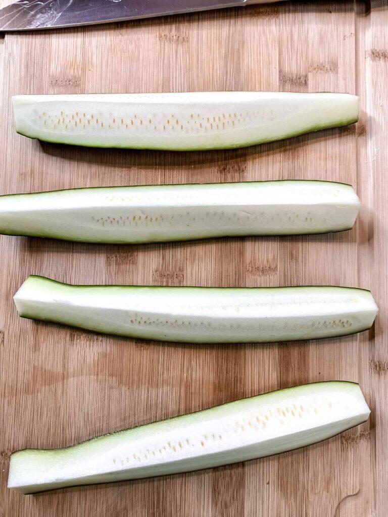 Zucchini halves cut into quarters lengthwise.