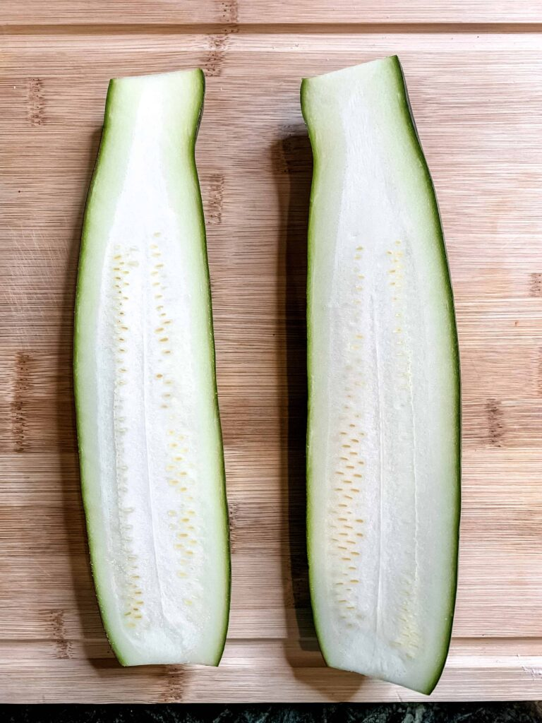 Large zucchini cut in half lengthwise.